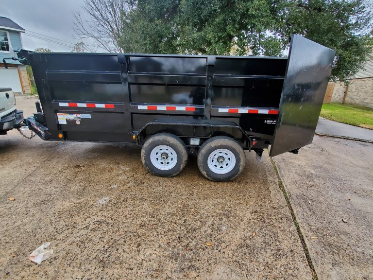 Dump trailer used for junk removal.